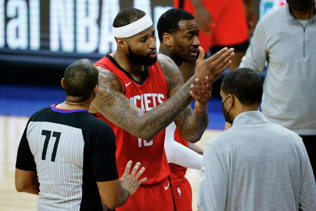 PHILADELPHIA, PENNSYLVANIA - FEBRUARY 17: DeMarcus Cousins #15 of the Houston Rockets speaks with referee Karl Lane #77 during the fourth quarter at Wells Fargo Center on February 17, 2021 in Philadelphia, Pennsylvania. NOTE TO USER: User expressly acknowledges and agrees that, by downloading and or using this photograph, User is consenting to the terms and conditions of the Getty Images License Agreement. Photo: Tim Nwachukwu, Getty Images / 2021 Getty Images