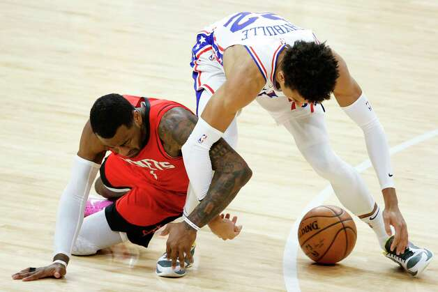 PHILADELPHIA, PENNSYLVANIA - FEBRUARY 17: John Wall #1 of the Houston Rockets and Matisse Thybulle #22 of the Philadelphia 76ers reach for a loose ball during the fourth quarter at Wells Fargo Center on February 17, 2021 in Philadelphia, Pennsylvania. NOTE TO USER: User expressly acknowledges and agrees that, by downloading and or using this photograph, User is consenting to the terms and conditions of the Getty Images License Agreement. Photo: Tim Nwachukwu, Getty Images / 2021 Getty Images