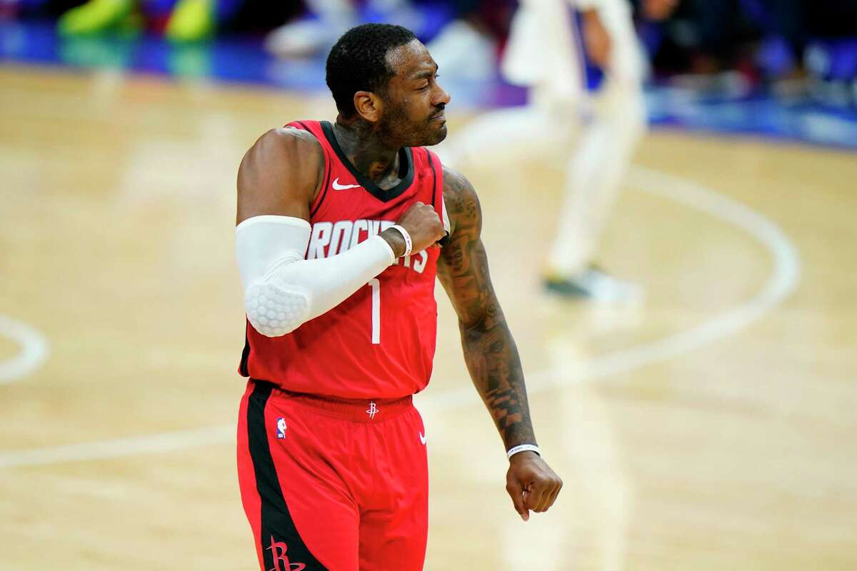 Houston Rockets' John Wall reacts after a basket during the second half of an NBA basketball game against the Philadelphia 76ers, Wednesday, Feb. 17, 2021, in Philadelphia. (AP Photo/Matt Slocum)