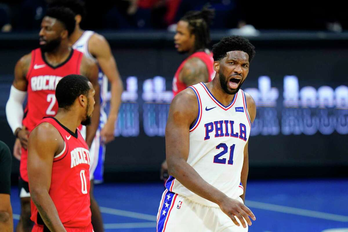 Philadelphia 76ers' Joel Embiid reacts after being called for a foul during the second half of an NBA basketball game against the Houston Rockets, Wednesday, Feb. 17, 2021, in Philadelphia. (AP Photo/Matt Slocum)