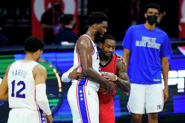 Philadelphia 76ers' Joel Embiid, left, and Houston Rockets' John Wall meet after an NBA basketball game, Wednesday, Feb. 17, 2021, in Philadelphia. (AP Photo/Matt Slocum) Photo: Matt Slocum, Associated Press / Copyright 2021 The Associated Press. All rights reserved