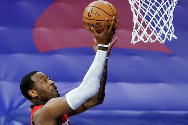 PHILADELPHIA, PENNSYLVANIA - FEBRUARY 17: John Wall #1 of the Houston Rockets shoots a lay up during the first quarter against the Philadelphia 76ers at Wells Fargo Center on February 17, 2021 in Philadelphia, Pennsylvania. NOTE TO USER: User expressly acknowledges and agrees that, by downloading and or using this photograph, User is consenting to the terms and conditions of the Getty Images License Agreement. Photo: Tim Nwachukwu, Getty Images / 2021 Getty Images