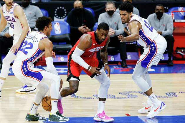 PHILADELPHIA, PENNSYLVANIA - FEBRUARY 17: Matisse Thybulle #22 of the Philadelphia 76ers strips John Wall #1 of the Houston Rockets during the first quarter at Wells Fargo Center on February 17, 2021 in Philadelphia, Pennsylvania. NOTE TO USER: User expressly acknowledges and agrees that, by downloading and or using this photograph, User is consenting to the terms and conditions of the Getty Images License Agreement. Photo: Tim Nwachukwu, Getty Images / 2021 Getty Images