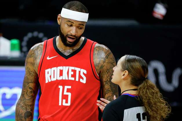 PHILADELPHIA, PENNSYLVANIA - FEBRUARY 17: DeMarcus Cousins #15 of the Houston Rockets speaks with referee Ashley Moyer-Gleich #13 during the first quarter at Wells Fargo Center on February 17, 2021 in Philadelphia, Pennsylvania. NOTE TO USER: User expressly acknowledges and agrees that, by downloading and or using this photograph, User is consenting to the terms and conditions of the Getty Images License Agreement. Photo: Tim Nwachukwu, Getty Images / 2021 Getty Images