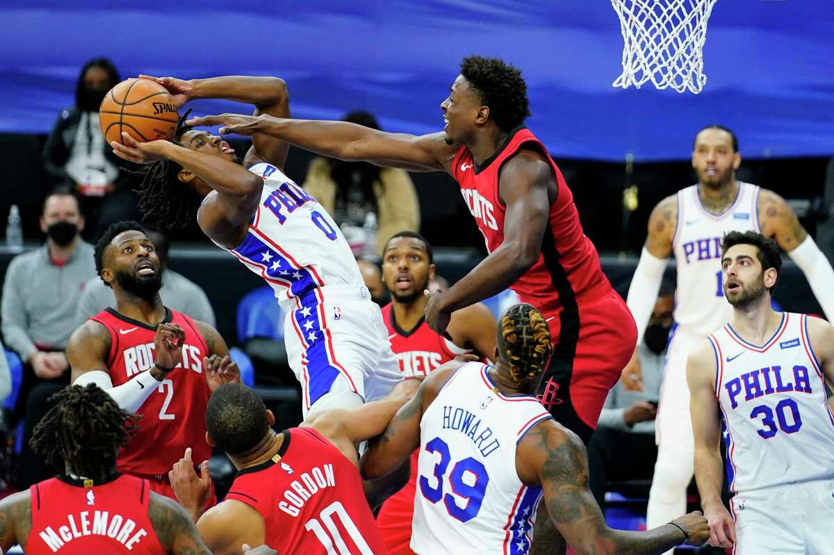 Philadelphia 76ers' Tyrese Maxey (0) goes up for a shot against Houston Rockets' Jae'Sean Tate during the second half of an NBA basketball game, Wednesday, Feb. 17, 2021, in Philadelphia. (AP Photo/Matt Slocum)