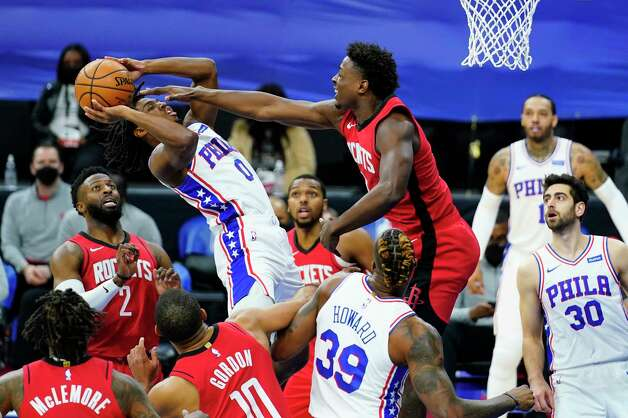 Philadelphia 76ers' Tyrese Maxey (0) goes up for a shot against Houston Rockets' Jae'Sean Tate during the second half of an NBA basketball game, Wednesday, Feb. 17, 2021, in Philadelphia. (AP Photo/Matt Slocum) Photo: Matt Slocum, Associated Press / Copyright 2021 The Associated Press. All rights reserved