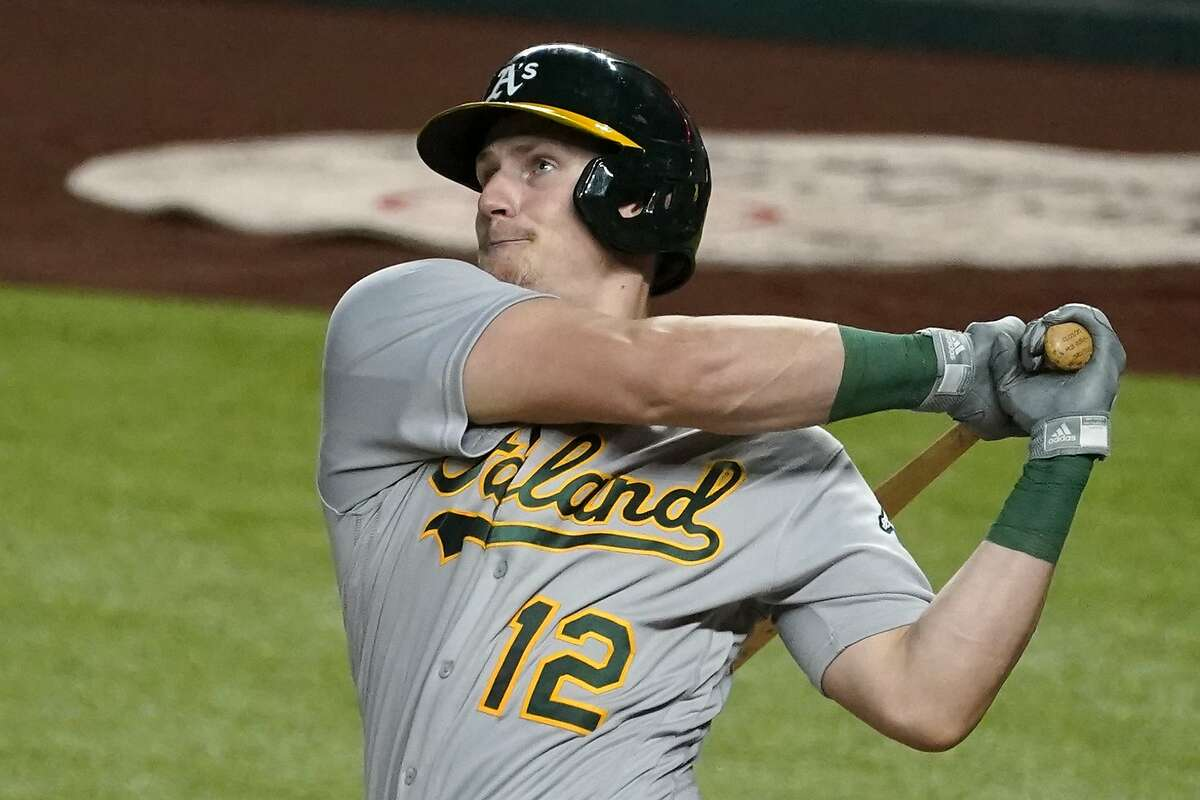 Catcher Sean Murphy, who had two operations after suffering a collapsed lung in January, is in camp with the A's.
