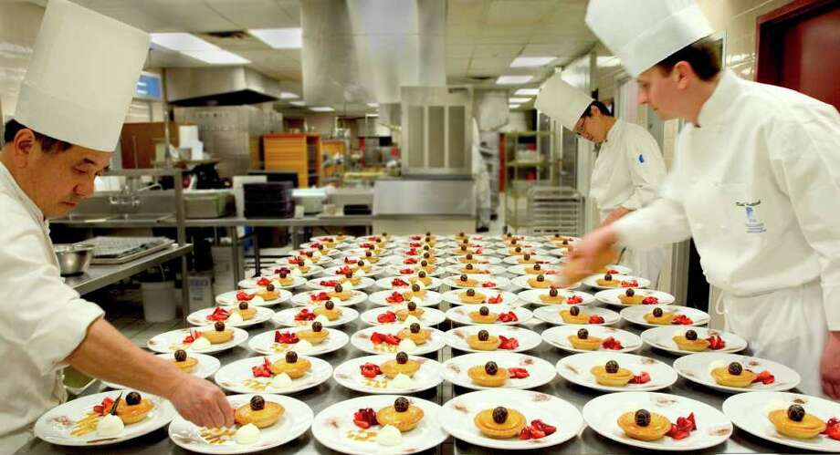 Chefs for Centerplate's Stir initiative working at its Vancouver Convention Center operations in Vancouver, Canada. Stir will seek to localize venue cuisine to enhance concession revenues. Photo: Contributed Photo / Stamford Advocate Contributed