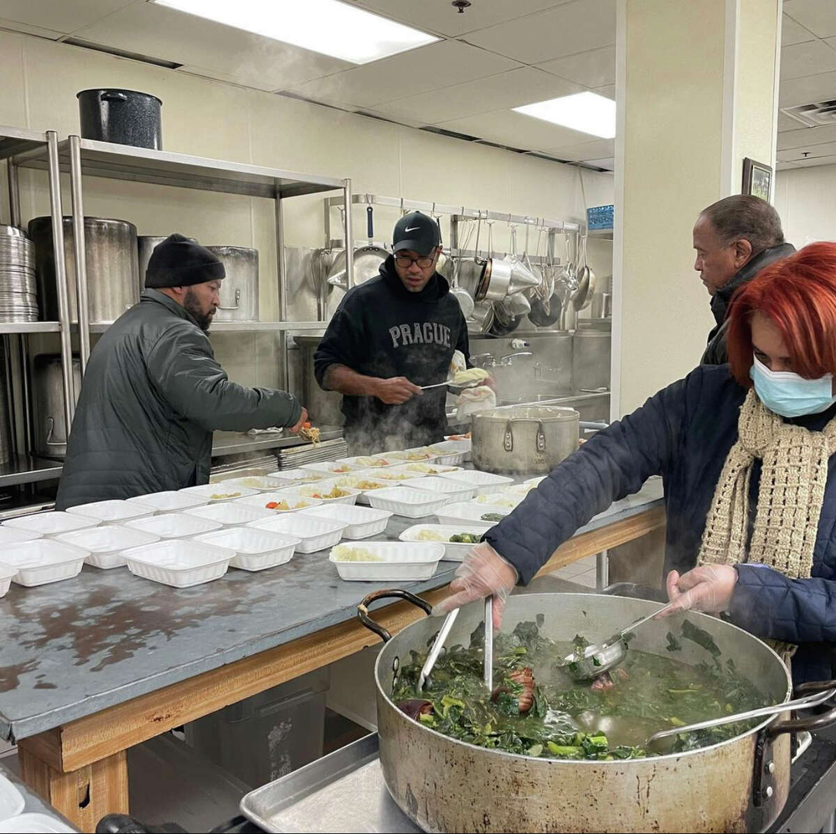 Chef Chris Williams (center) and his brother Ben Williams (left) gave meals out to Houstonians struggling during the February 2021 winter storm.