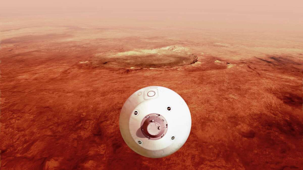 In this illustration made available by NASA, The aeroshell containing the Perseverance rover guides itself towards the Martian surface as it descends through the atmosphere. (NASA/JPL-Caltech via AP)