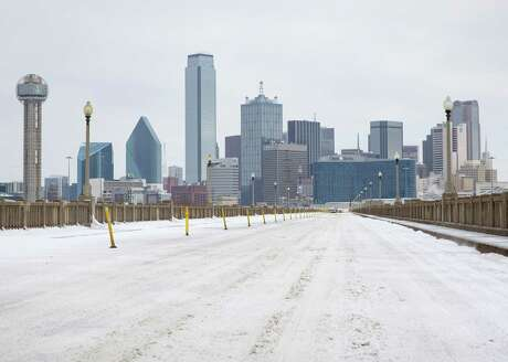 A snow-covered downtown Dallas seen from South Houston Street on Monday, Feb. 15, 2021. (Juan Figueroa/The Dallas Morning News/TNS)