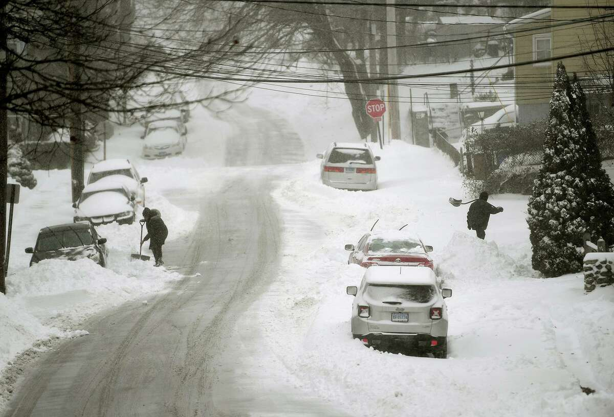 A file photo of a snow-covered Elm Street in Shelton, Conn., taken on Dec. 17, 2020.
