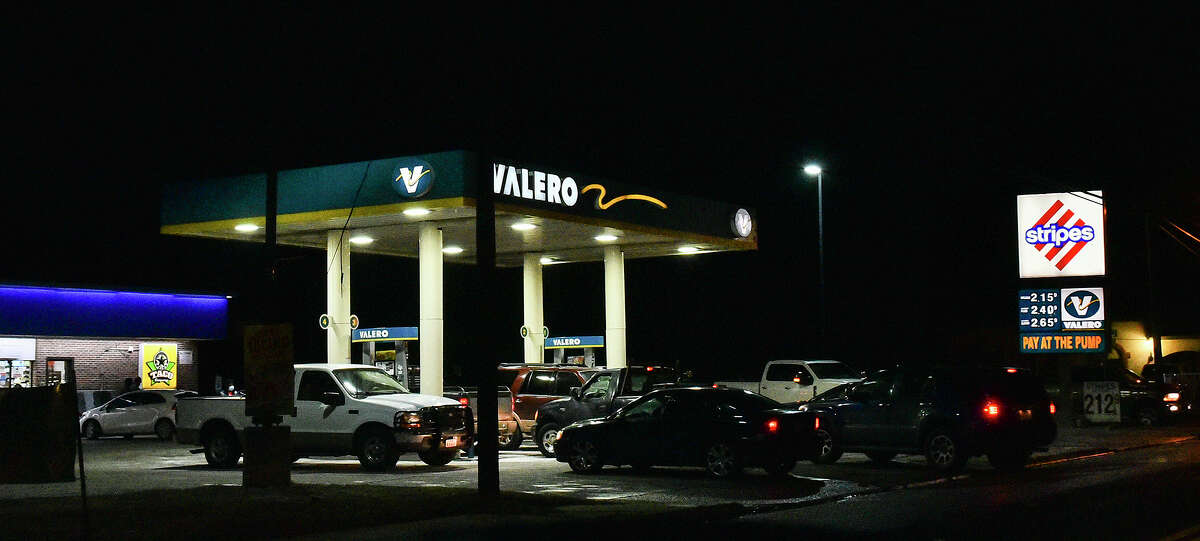 Motorists crowd a Stripes gas station on Arkansas Avenue amid a black out affecting other gas stations, Monday, Feb. 15, 2021, as Laredo experiences freezing temperatures following a winter storm.