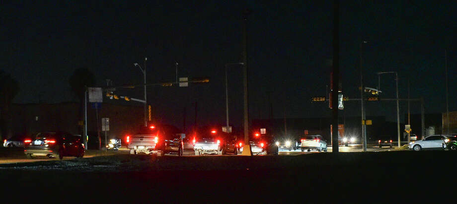 Motorists navigate through the Arkansas Avenue and East Saunders Street intersection during a black out affecting multiple parts of Laredo, Monday, Feb. 15, 2021, as Laredo experiences freezing temperatures following a winter storm. Photo: Danny Zaragoza/Laredo Morning Times