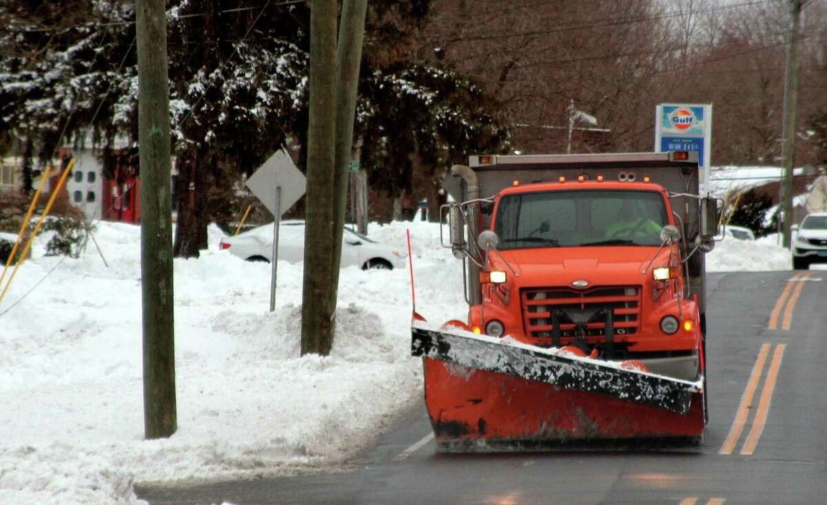 Snow cleanup continues after a nor'easter in Trumbull, Conn., on Tuesday Feb. 2, 2020.