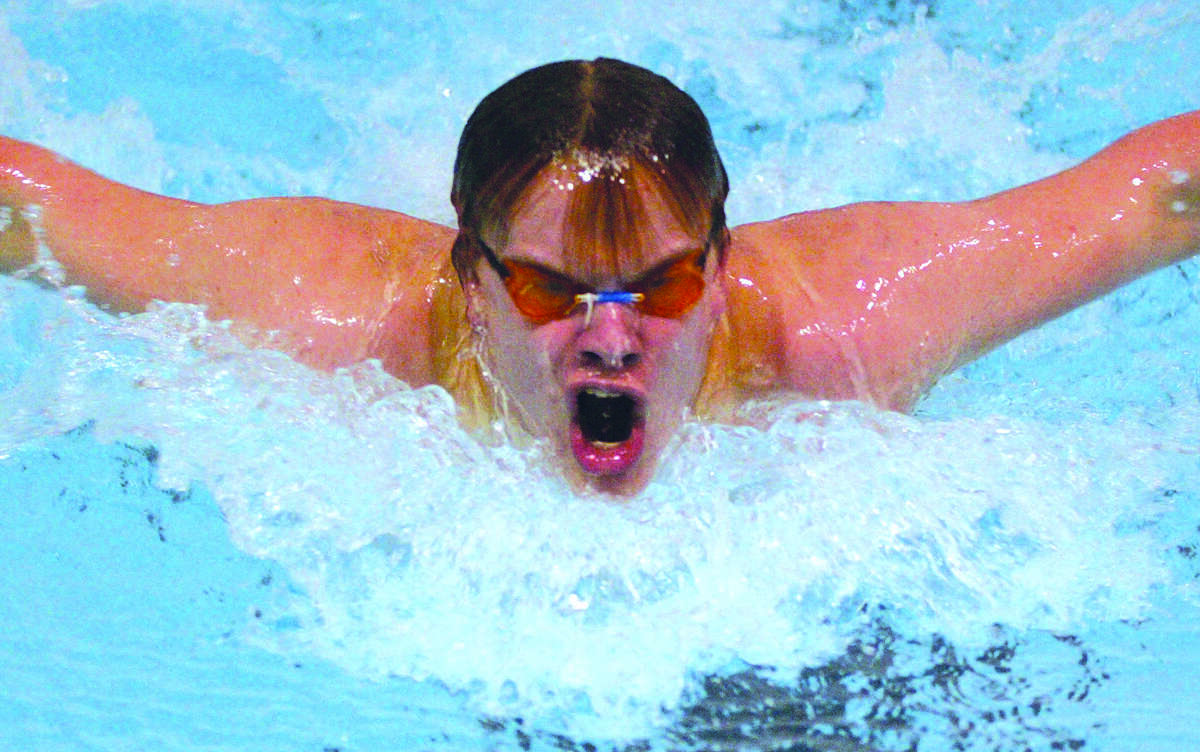 Middletown's Foster Charles comes up for air during the butterfly race. Middletown came up short against East Hartford Friday night.......photo by Sarah Schultz.....1.14.05