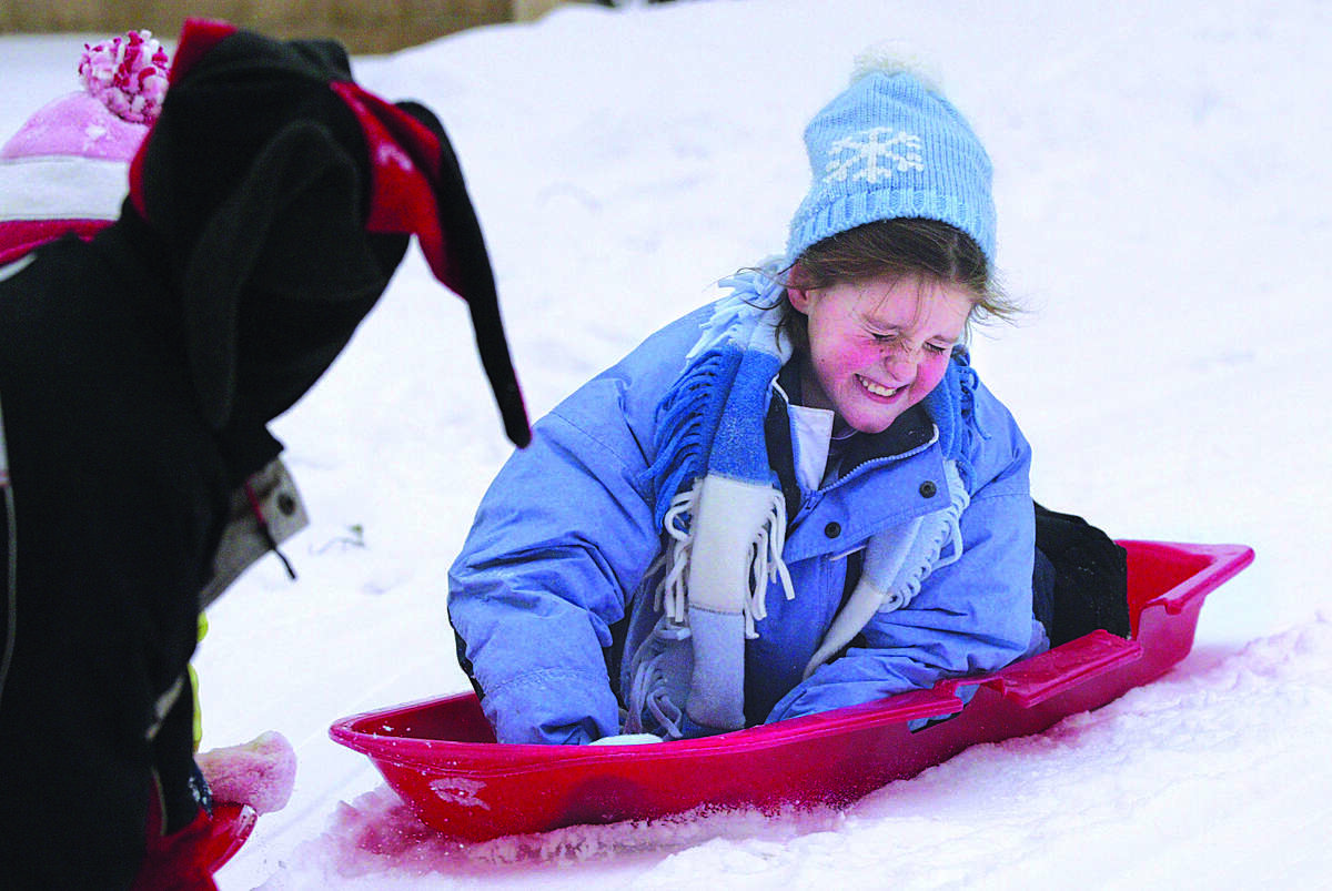 Molly Donahue, age 8, of Portland, braces for impact while she sleds outside of her house in Portland Wednesday afternoon........photo by Sarah Schultz......1.26.05