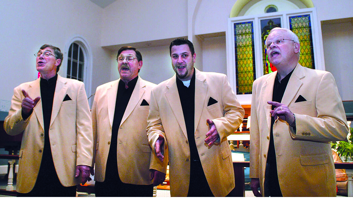 Chris Hall, Mike Packwvicz, Bryan Ranno and Bob Ranno sing for Middlefield Federated Church Saturday night in Middlefield as a part of the church's Barbershop Quartet and Chili Cook-off......photo by Sarah Schultz......2.5.05