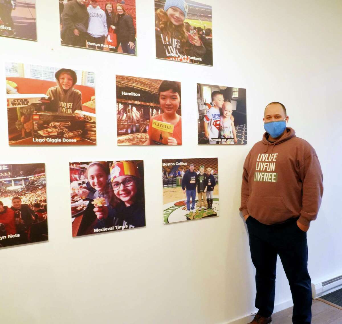 LivFree, an organization to help families impacted by pediatric cancer, has moved to 107 Main St. in New Canaan. Daniel Vieira showed off the store front, which has many pictures of the over 300 families the nonprofit has sponsored for a fun outing. Pictures were taken Feb. 17, 2021.