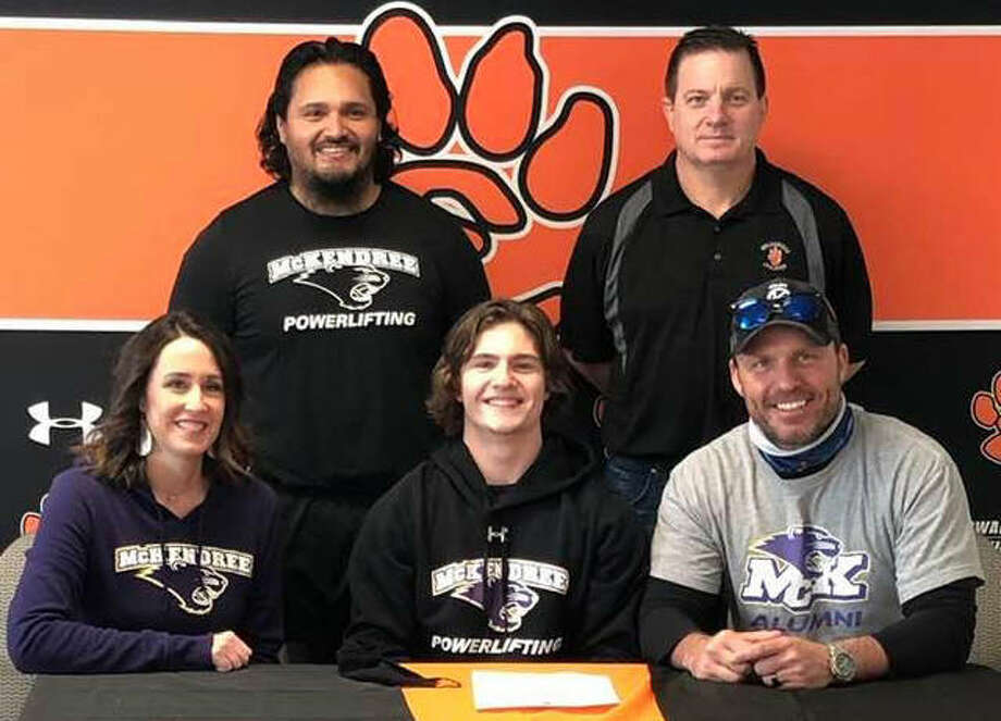 Edwardsville High School senior Maxon Karnes, seated center, will compete for the powerlifting team at McKendree University. He is joined by his parents, EHS wrestling coach Jon Wagner and McKendree powerlifting coach Guillermo Blanco. Photo: For The Intelligencer