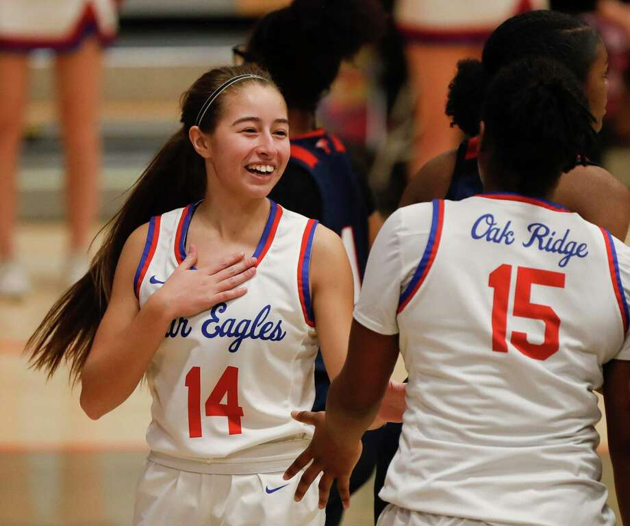 Oak Ridge's Kylie Weeks (14) laughs with Allison Owens (15) after the two collided during the third quarter of a Region II-6A bi-district high school basketball playoff game at Grand Oaks High School, Thursday, Feb. 11, 2021, in Spring. Photo: Jason Fochtman, Houston Chronicle / Staff Photographer / 2021 © Houston Chronicle
