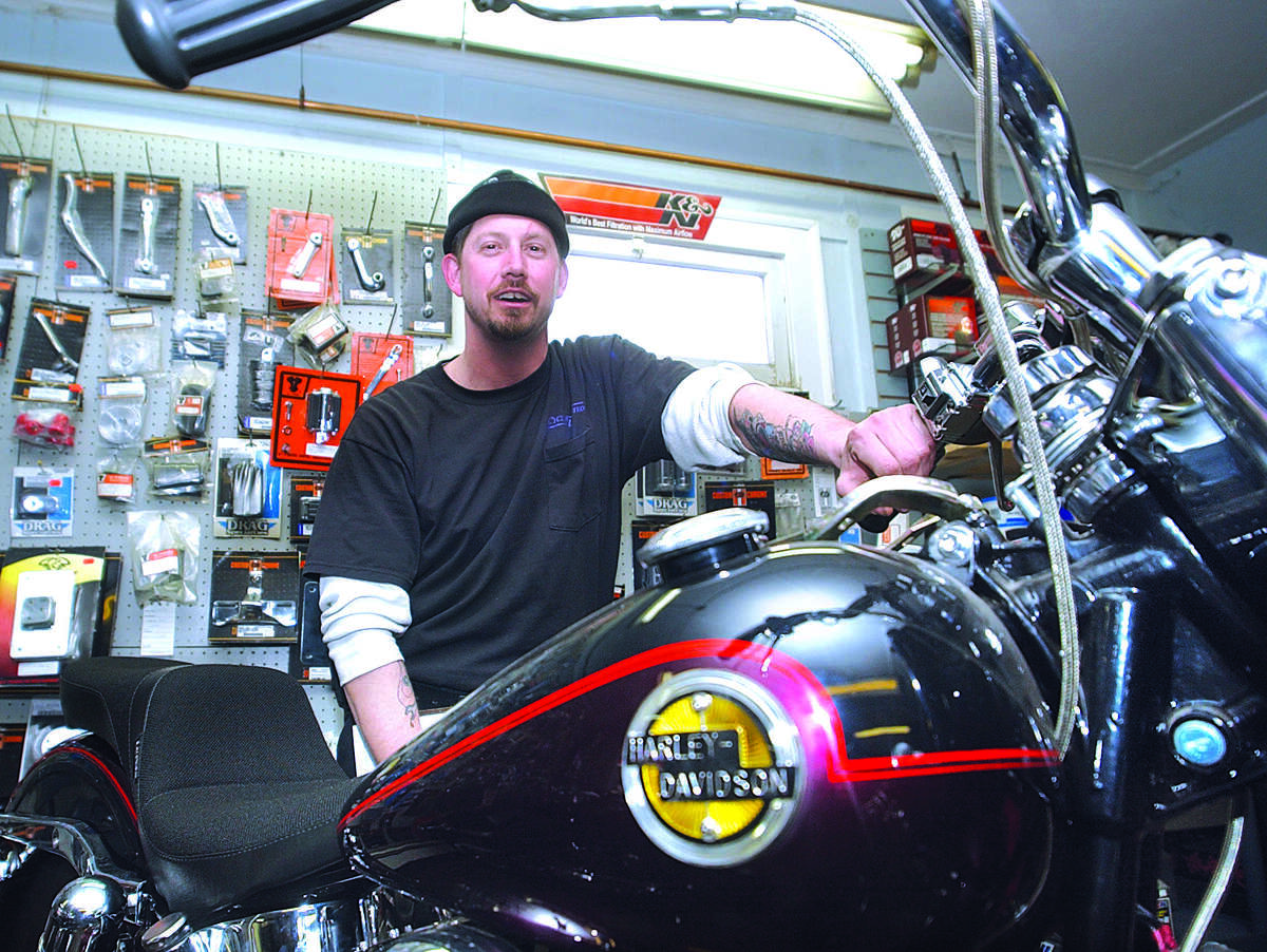 Mark Polansky, of Durham, stands by a 1958 Harley Davidson, which he is building for his uncle, at his shop, Cycle's Unlimited, in Portland. Beginning mid-January and carrying through the fall Polansky is swamped with repairs and restorations......photo by Sarah Schultz.....3.17.05