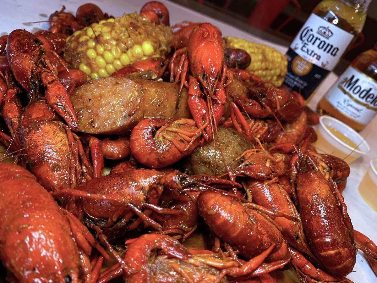 This spicy Cajun crawfish boil at LA Crawfish is customized with corn, potatoes and andouille sausage.