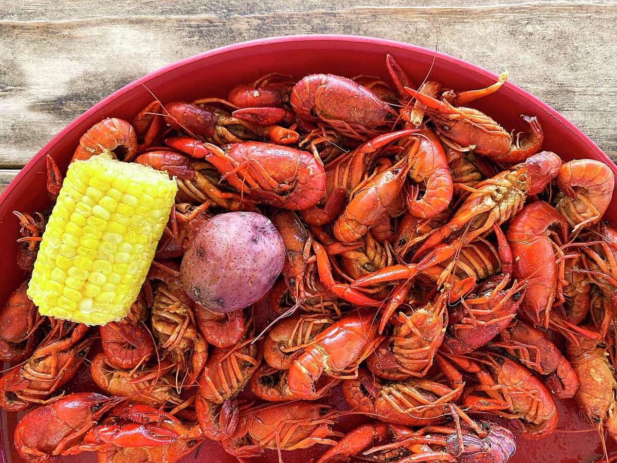 A crawfish boil at Comal Crawfish Co. in New Braunfels can include extras like corn and potatoes.