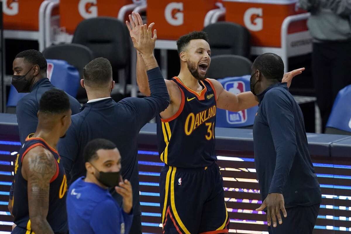 Golden State Warriors guard Stephen Curry celebrates after scoring against the Miami Heat on Feb. 17, 2021.