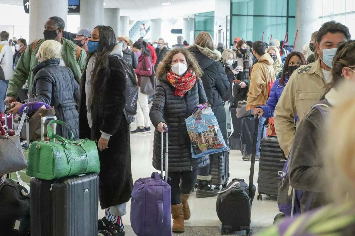 Travels wait in long lines as all flights at William P. Hobby Airport resumed after water issues forced officials to cancel or divert all flights yesterday Thursday, Feb. 18, 2021, in Houston.