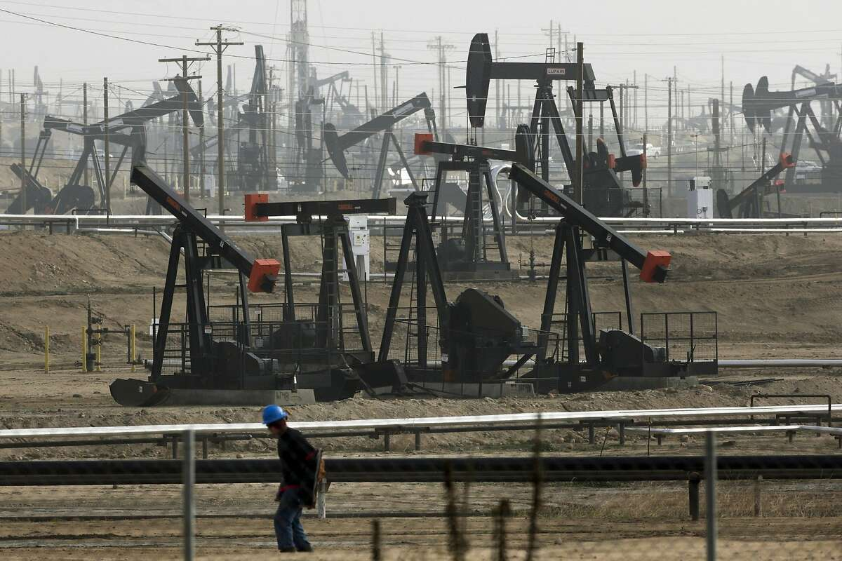 Pumpjacks are seen operating in Bakersfield in 2015. On Friday, Gov. Gavin Newsom set in motion a process that will end new permits for the oil extraction method known as fracking by 2024.