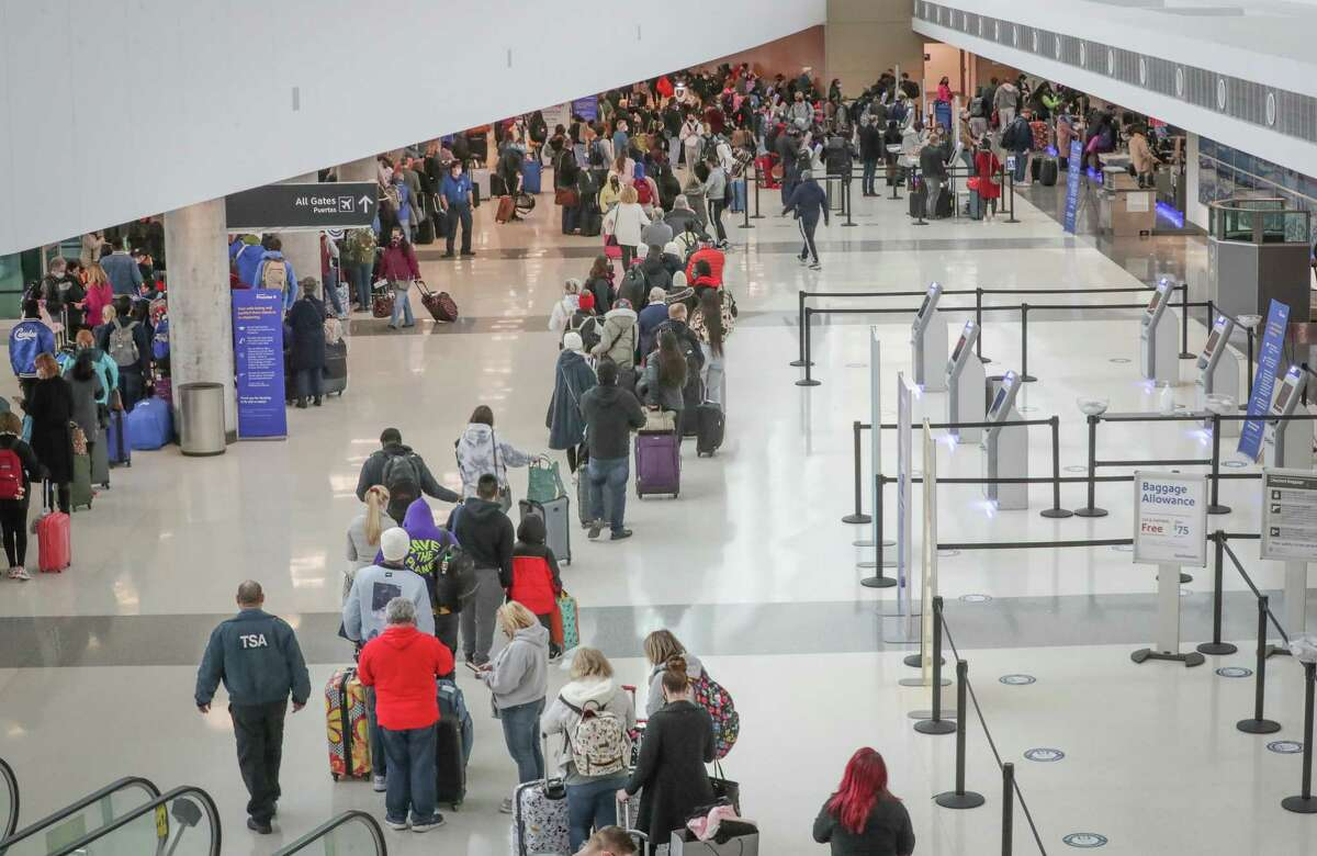 Long lines awaited travelers as all flights at William P. Hobby Airport resumed after water issues forced officials to cancel or divert all flights yesterday Thursday, Feb. 18, 2021, in Houston.