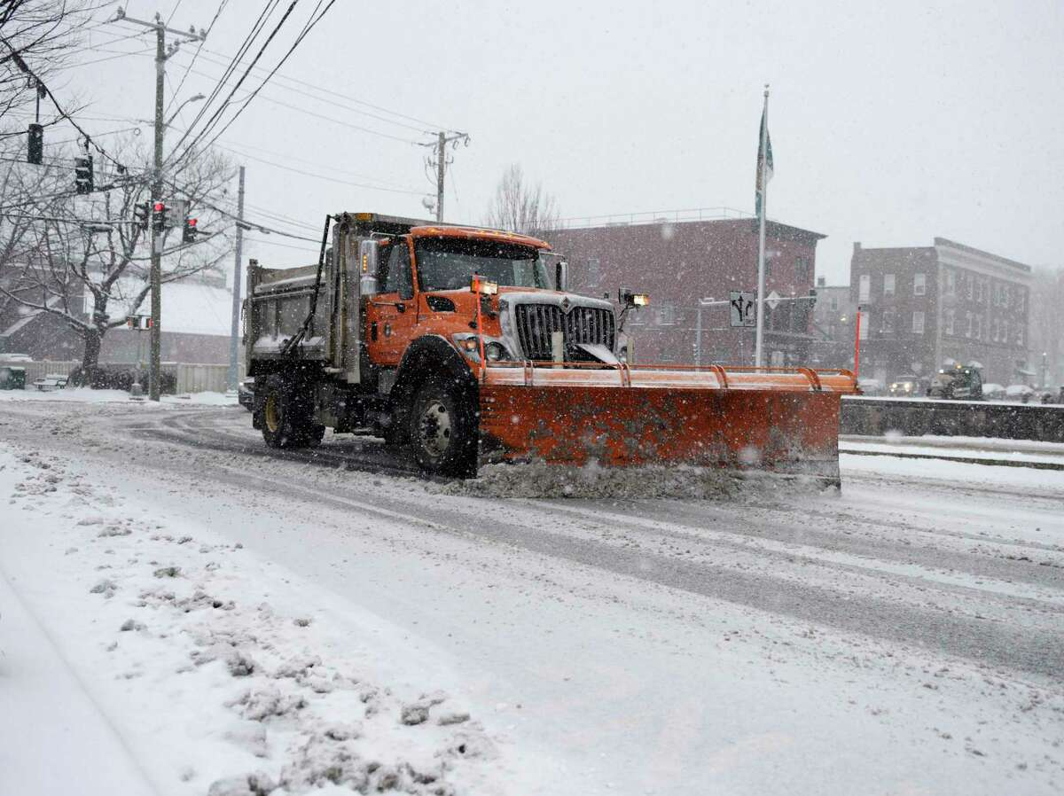 A plow clears snow from Mason Street in Greenwich, Conn. Thursday, Feb. 18, 2021. The area received a blanketing of snow starting Thursday morning that is expected to last into Friday.