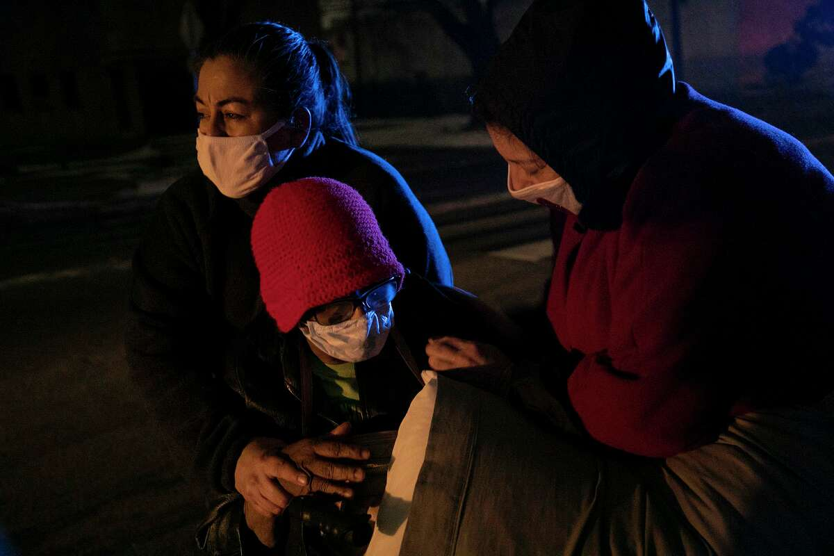 Community advocates guide a woman to a shelter during a winter freeze that left many homes without electricity and water. A reader expects more foresight for extreme weather from Gov. Greg Abbott.