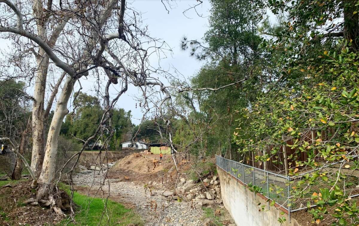 Several tree stumps and slabs of concrete are all that remain of this section of Saratoga Creek, which once surged with runoff from the Santa Cruz Mountains.