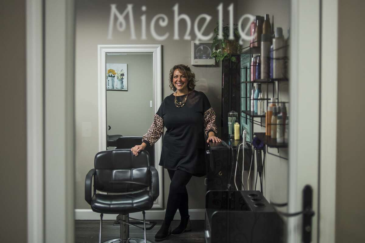 Michelle Lange poses for a portrait inside her new business, Lavish Style Studios, Wednesday, Feb. 17, 2021 at 4915 Hedgewood Drive in Midland. (Katy Kildee/kkildee@mdn.net)