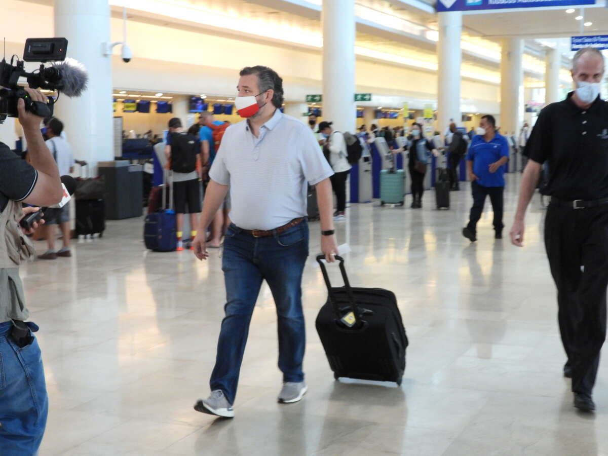 CANCUN, MEXICO - FEBRUARY 18: Sen. Ted Cruz (R-TX) checks in for a flight at Cancun International Airport after a backlash over his Mexican family vacation as his home state of Texas endured a Winter storm on February 18, 2021 in Cancun, Quintana Roo, Mexico. The Republican politician came under fire after leaving for the warm holiday destination as hundreds of thousands of people in the lone star state suffered a loss of power. Reports stated that Cruz was due to catch a flight back to Houston, Texas. (Photo by MEGA/GC Images)
