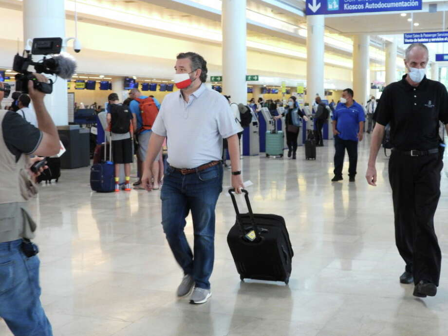 CANCUN, MEXICO - FEBRUARY 18: Sen. Ted Cruz (R-TX) checks in for a flight at Cancun International Airport after a backlash over his Mexican family vacation as his home state of Texas endured a Winter storm on February 18, 2021 in Cancun, Quintana Roo, Mexico. The Republican politician came under fire after leaving for the warm holiday destination as hundreds of thousands of people in the lone star state suffered a loss of power. Reports stated that Cruz was due to catch a flight back to Houston, Texas. (Photo by MEGA/GC Images) Photo: MEGA/GC Images / 2021 MEGA