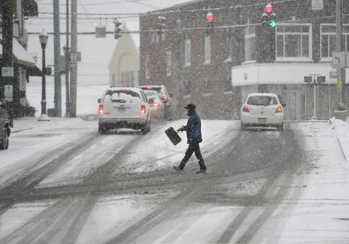 A winter storm coats streets in a fresh layer of snow in Milford, Conn. on Thursday, February 18, 2021.