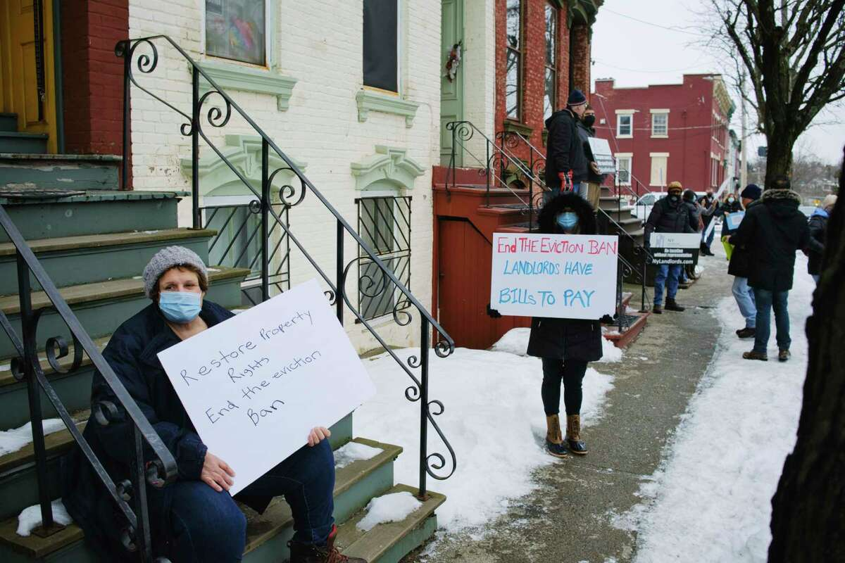 Landlord Mary Colatosti, left, of East Greenbush, joins other landlords from around New York State for a protest outside the New York State Governor's Mansion on Thursday, Feb. 18, 2021, in Albany, N.Y. Landlords say that the current eviction moratorium is severely hurting small landlords. (Paul Buckowski/Times Union)
