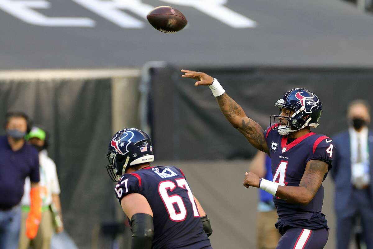Deshaun Watson of the Houston Texans passes during the first half against the Tennessee Titans on Jan. 3, 2021.