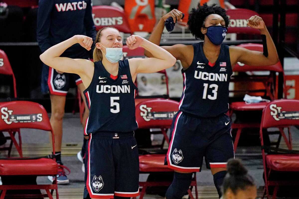 UConn's Paige Bueckers (5) and Christyn Williams (13) react from the bench during the fourth quarter of the Huskies' 77-32 win at St. John's on Wednesday.