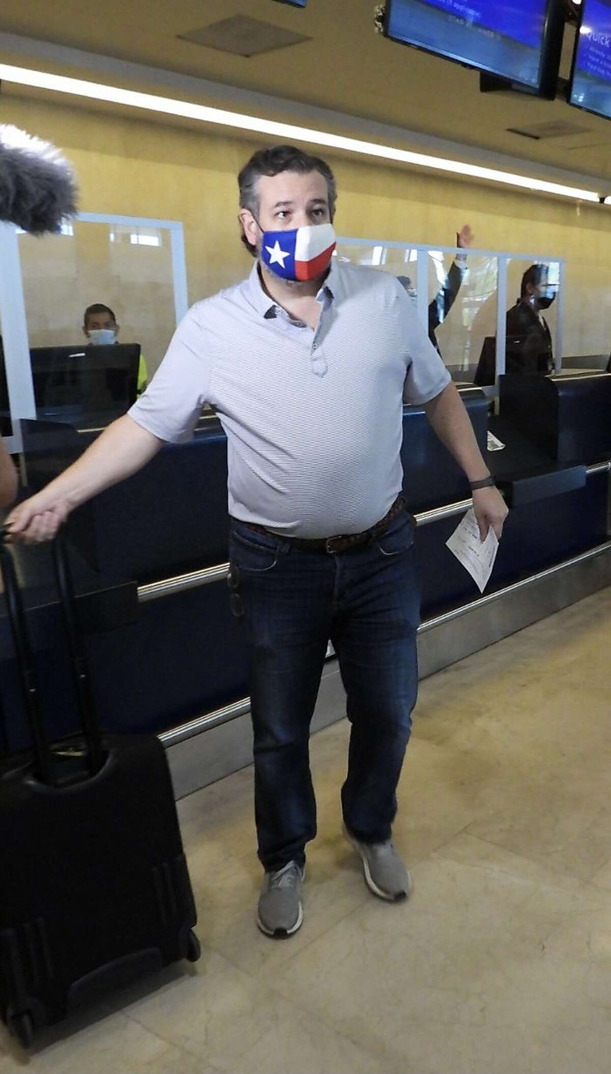 Sen. Ted Cruz (R-TX) checks in for a flight at Cancun International Airport after a backlash over his Mexican family vacation as his home state of Texas endured a Winter storm on February 18, 2021 in Cancun, Quintana Roo, Mexico. The Republican politician came under fire after leaving for the warm holiday destination as hundreds of thousands of people in the lone star state suffered a loss of power. Reports stated that Cruz was due to catch a flight back to Houston, Texas.