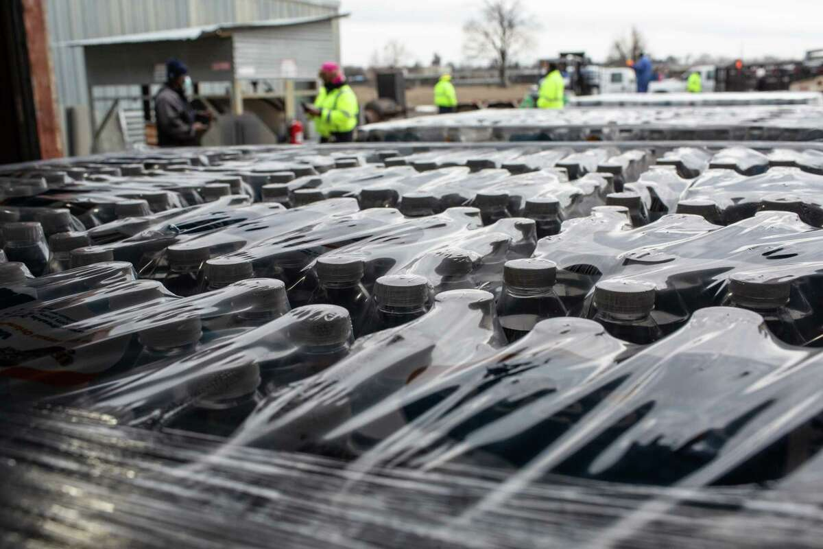 Bottled water placed on pallets at the City of Houston Upper Braes Warehouse to be delivered to vulnerable populations in the City of Houston during a boil water notice, Thursday, Feb. 18, 2021, in Houston.