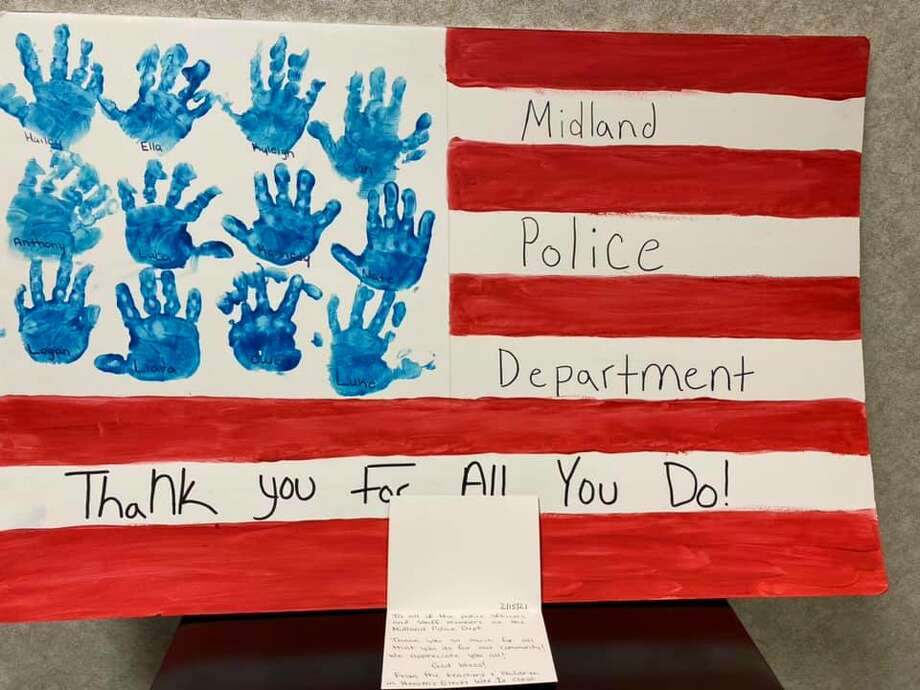 Staff members and students of Heaven's Elect preschool and daycare sent a handmade thank you note to the City of Midland Police Department on Wednesday. The card was part of Heaven's Elect's Community Helpers Month project. Photo: Photo Provided/Facebook