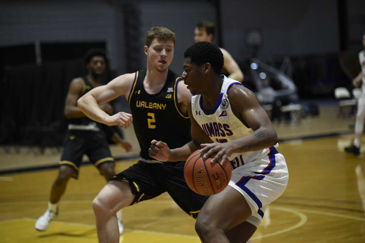 UAlbany sophomore Trey Hutcheson defends against UMass Lowell forward Allin Blunt in an America East game on Feb. 13. The Danes will take on Stony Brook on the final weekend of the regular season.(Kathleen Helman/UAlbany Athletics)