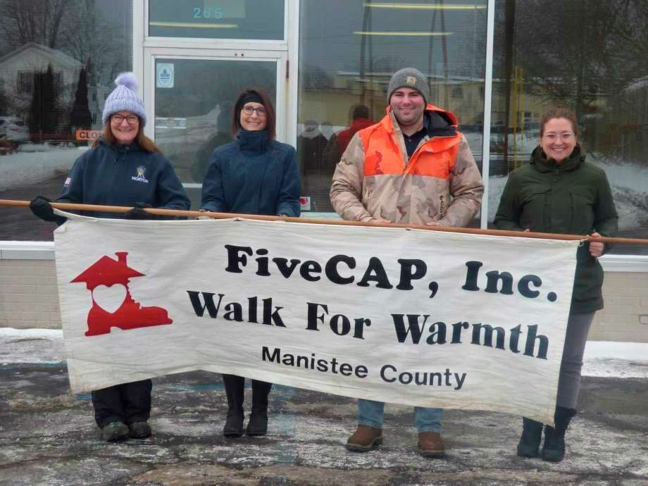 (From left) Laurie Blevins, Candace Owens, Tyler Dula and Kendra Pollard prepare for the 2020 Walk for Warmth, a fundraiser intended to support families struggling with heating costs in winter. This year's event willtake place from 10 a.m. to noon on Saturday, starting at the Manistee County FiveCAP Office, located at 265 First St.(File photo)