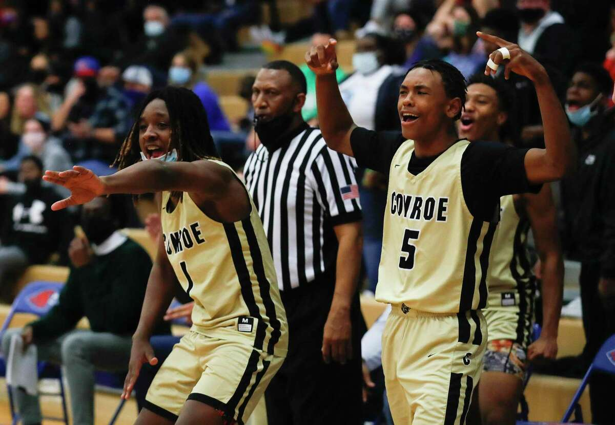 Conroe players react after a basket by Mikey Sneed during the third quarter of a District 13-6A high school basketball game at Oak Ridge High School, Friday, Feb. 12, 2021.