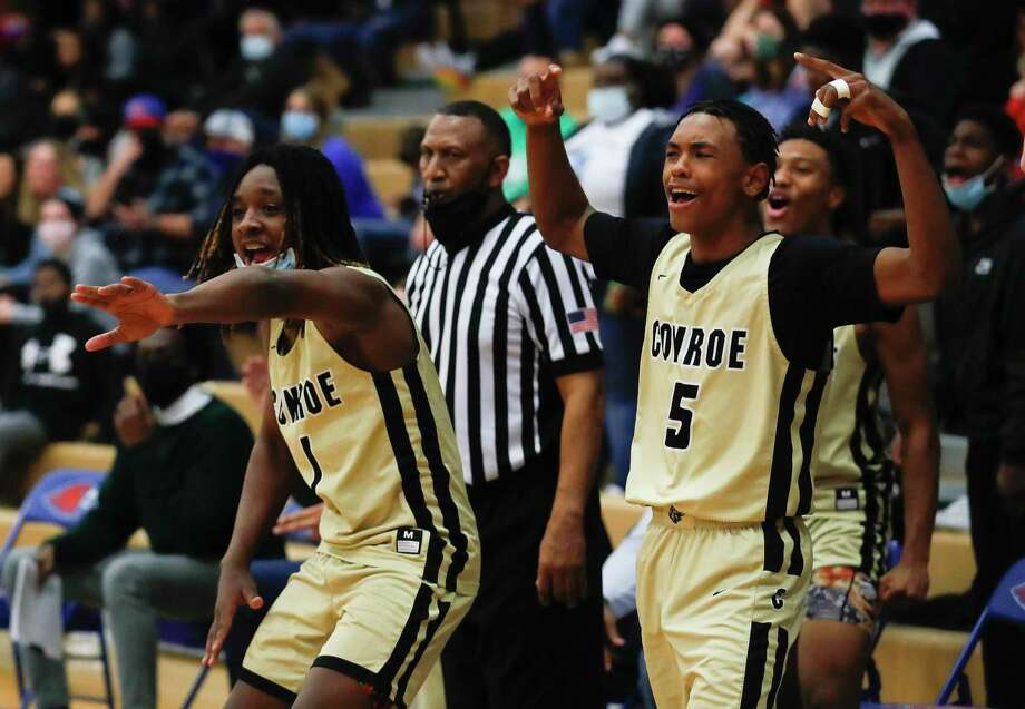 Conroe players react after a basket by Mikey Sneed during the third quarter of a District 13-6A high school basketball game at Oak Ridge High School, Friday, Feb. 12, 2021. Photo: Jason Fochtman, Houston Chronicle / Staff Photographer / 2021 © Houston Chronicle