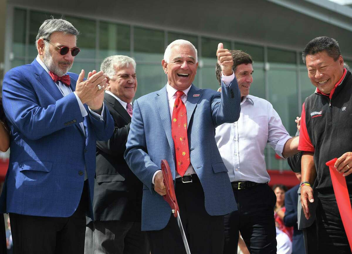 Sacred Heart University Athletic Director and former major league baseball player and manager Bobby Valentine cuts the ribbon on the new Bobby Valentine Health & Recreation Center at the school in Fairfield, Conn. on Tuesday, August 27, 2019. At left is university President John Petillo.